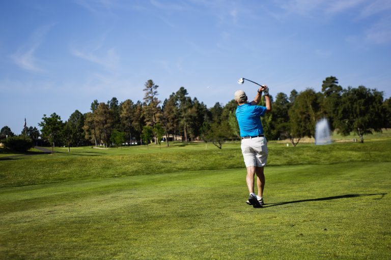 A golfer tees off at Continental Country Club